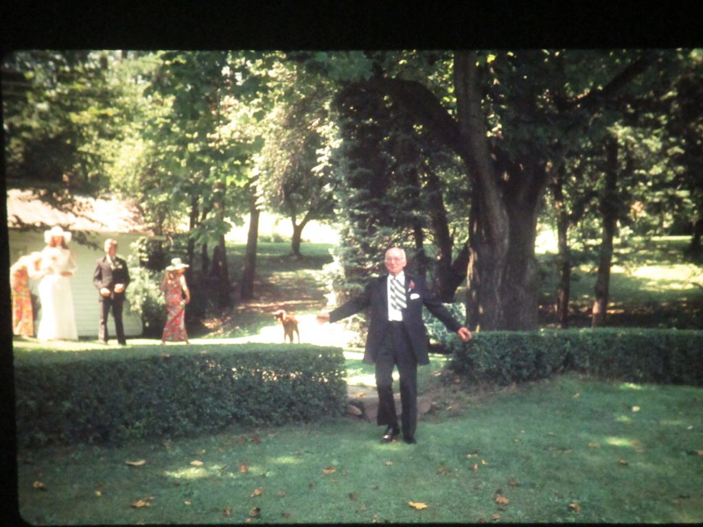 Mary Meyer's Father, William Hockenberry, August 11, 1973 walking through the privet hedge at her wedding reception at the family farm.