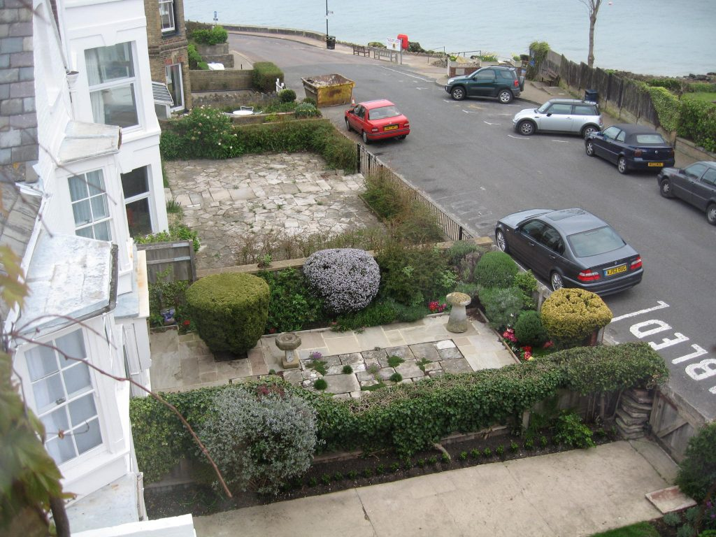 Small front yard English gardens with dense hedge plantings.